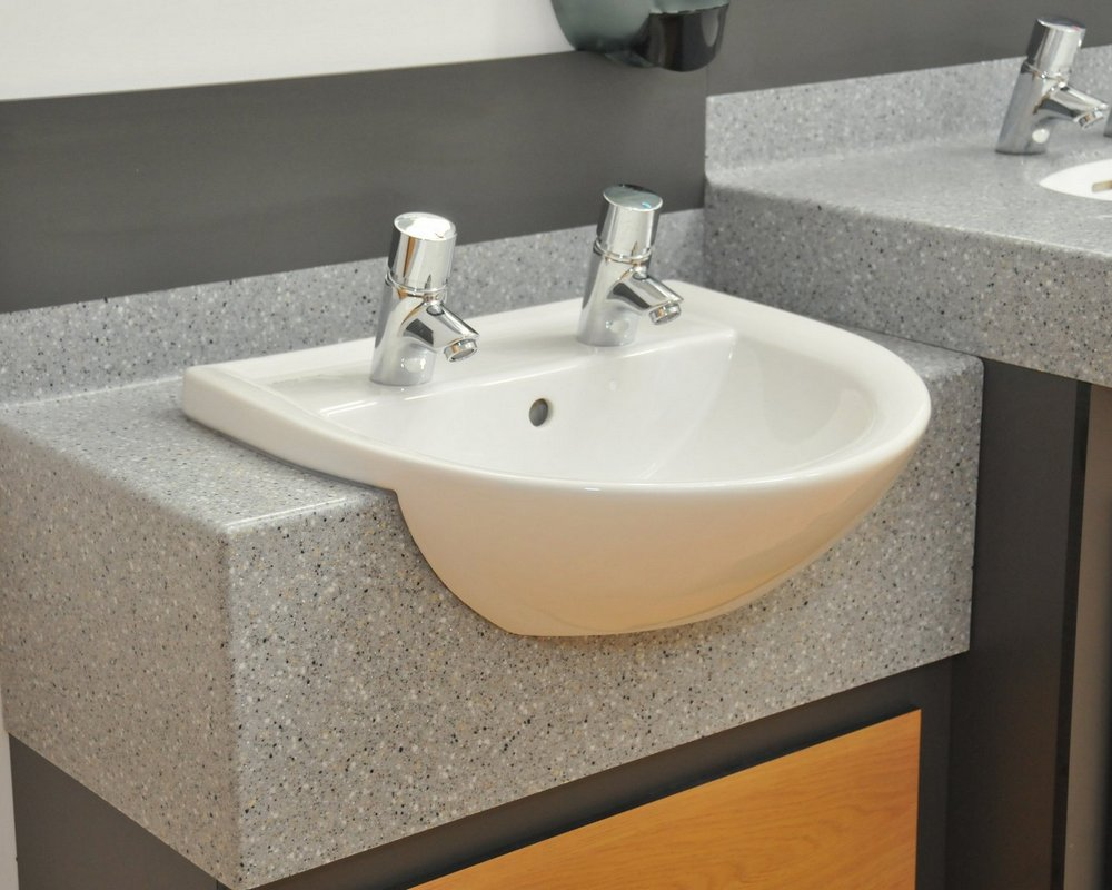 Woodlands Caravan Park semi recessed basin for children on a solid surface vanity unit