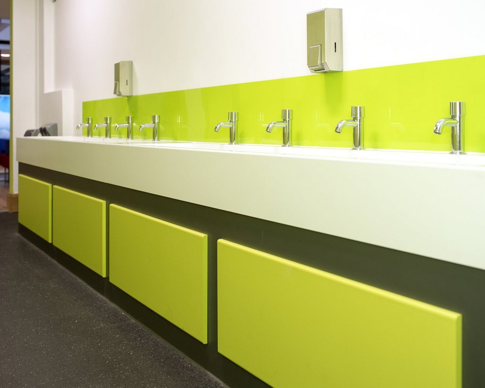 Ysgol Gyfun Ystalyfera solid surface washtrough with grey 'Welsh Slate' and green 'Zest' under vanity
