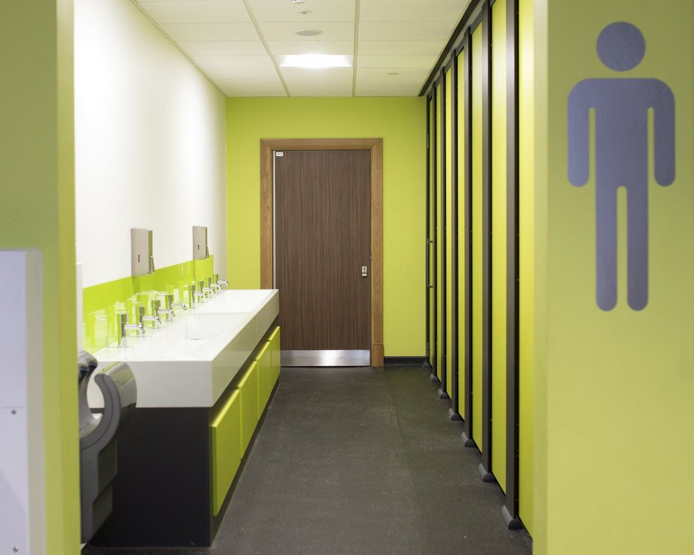 Ysgol Gyfun Ystalyfera male washrooms with HiZone cubicle and a solid surface washtrough