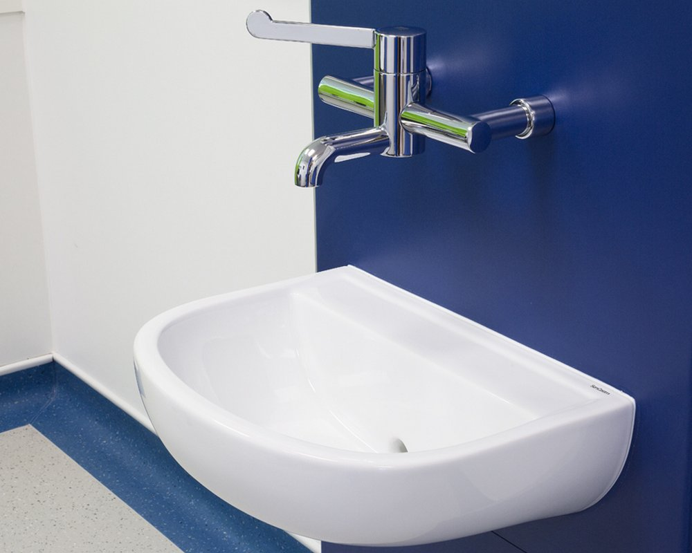 SanCeram clinical basin and mixer tap on blue healthcare boxed out unit.
