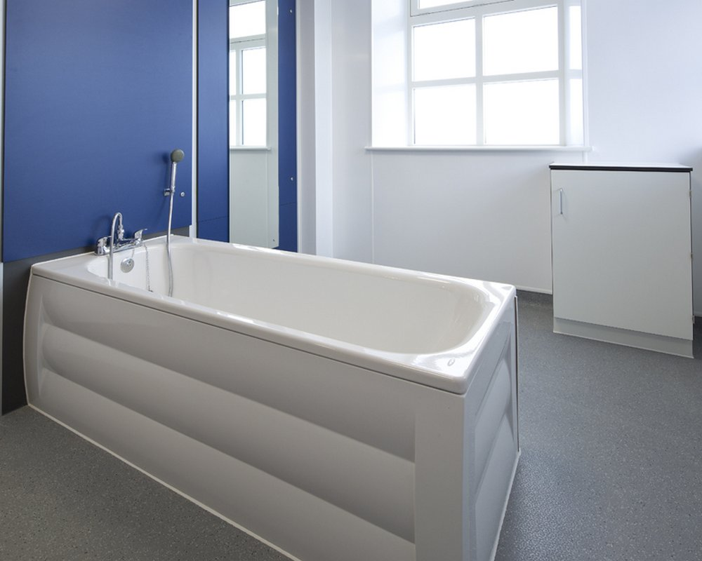 SanCeram white hospital bath ready plumbed to blue IPS panel