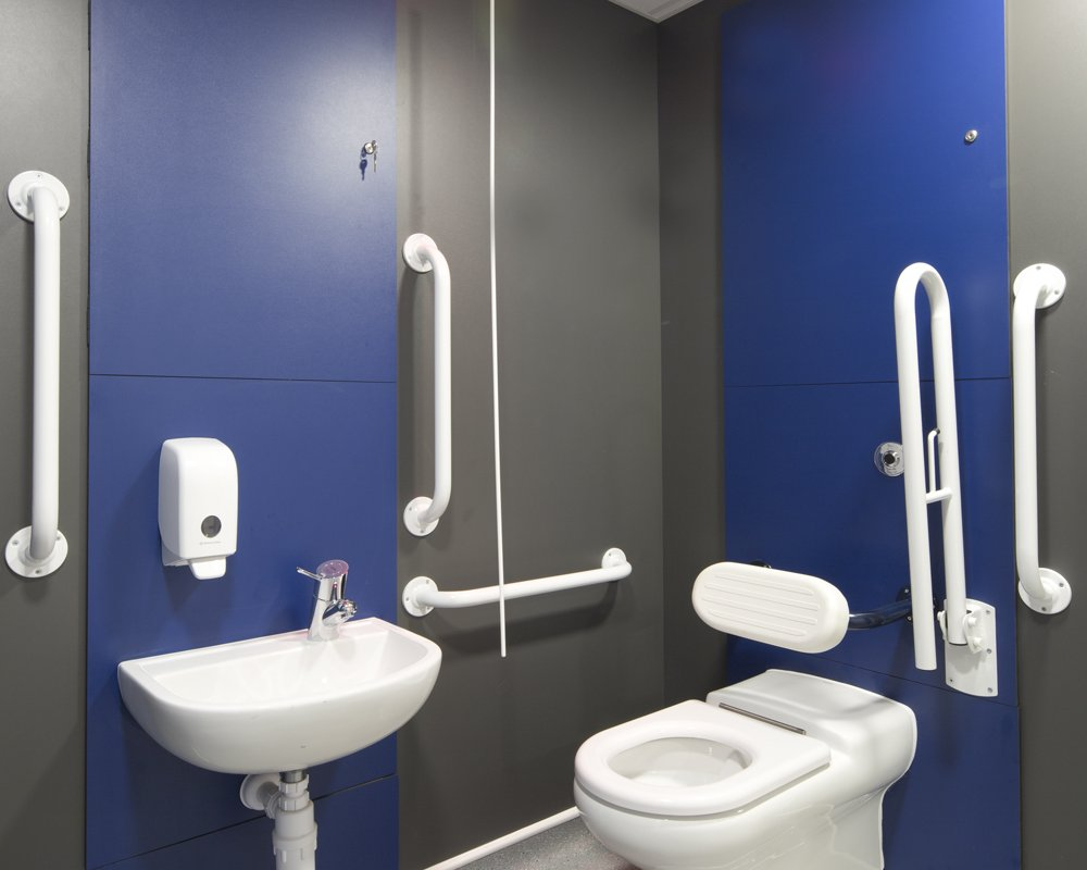 Disabled toilet with full white SanCeram Doc M pack