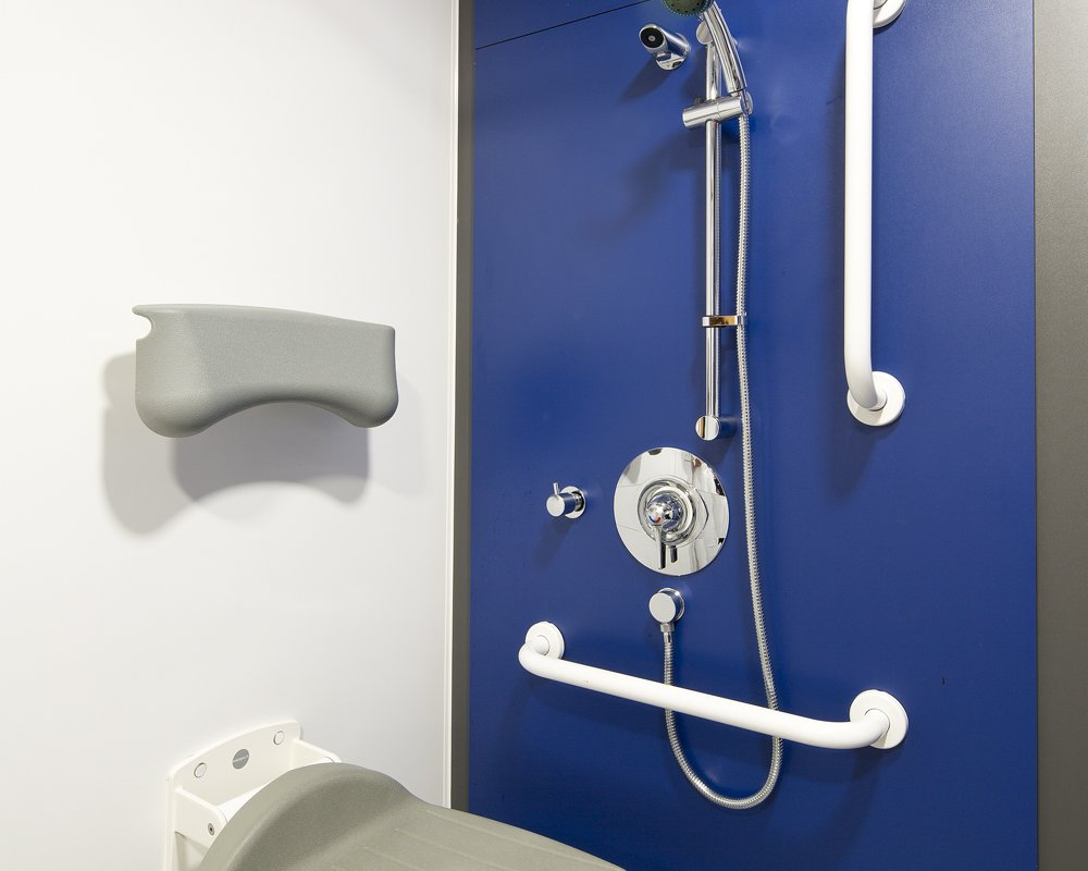 Disabled shower area with blue panels at Acre Mills Hospital