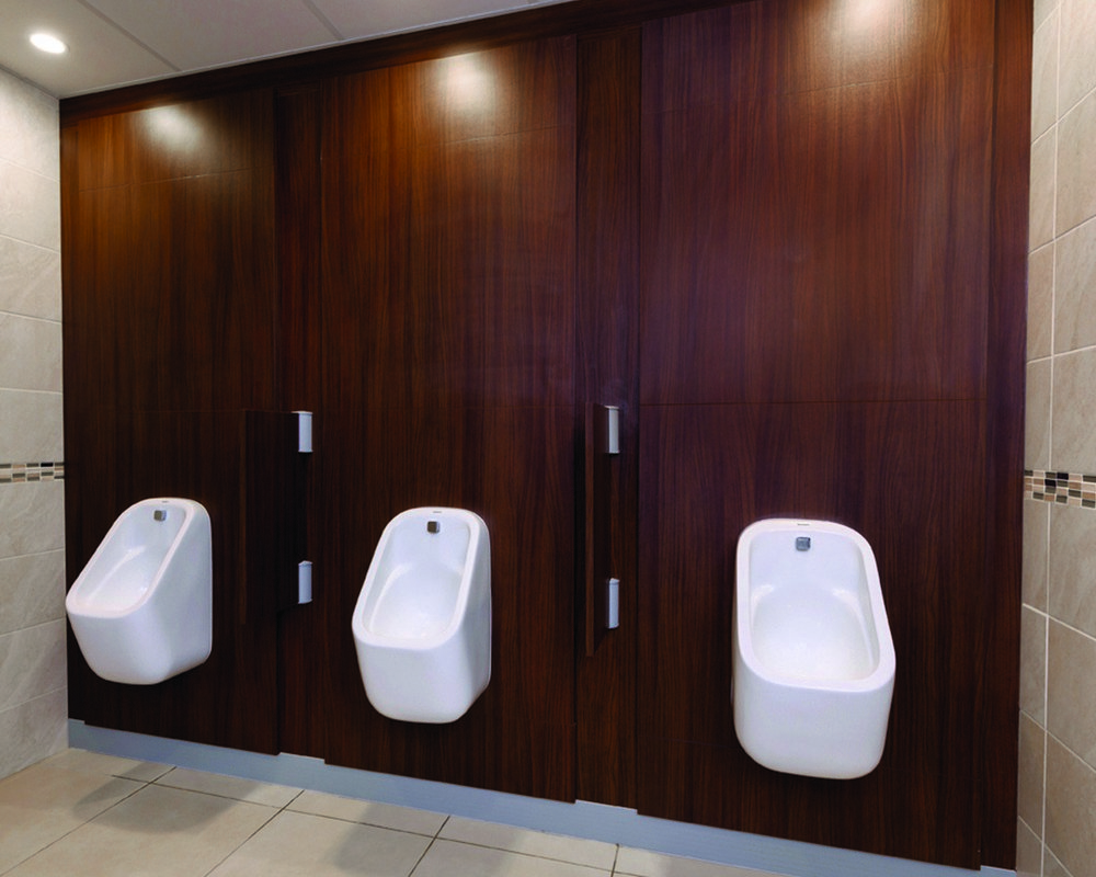 The Church of Scientology urinals pre-plumbed onto American Walnut IPS panels