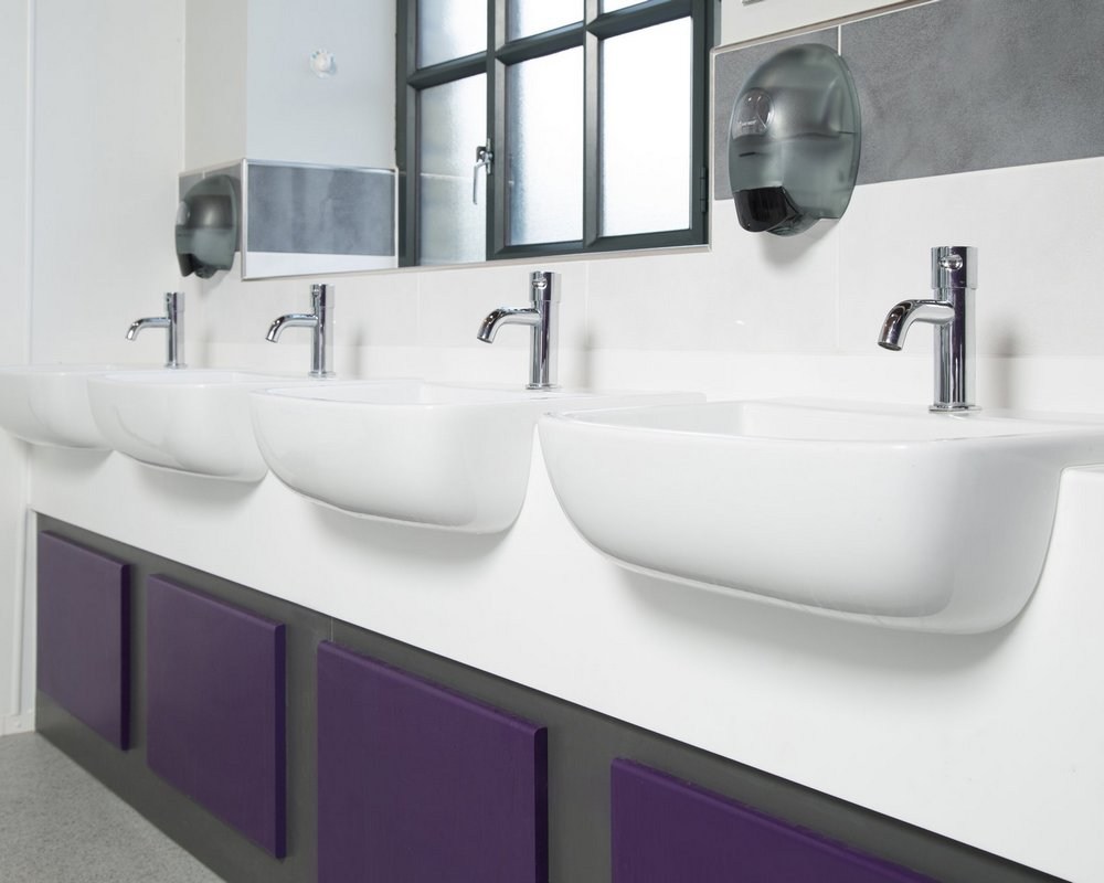 Huddersfield University semi recessed vanity unit with white 'Elysian' solid surface top