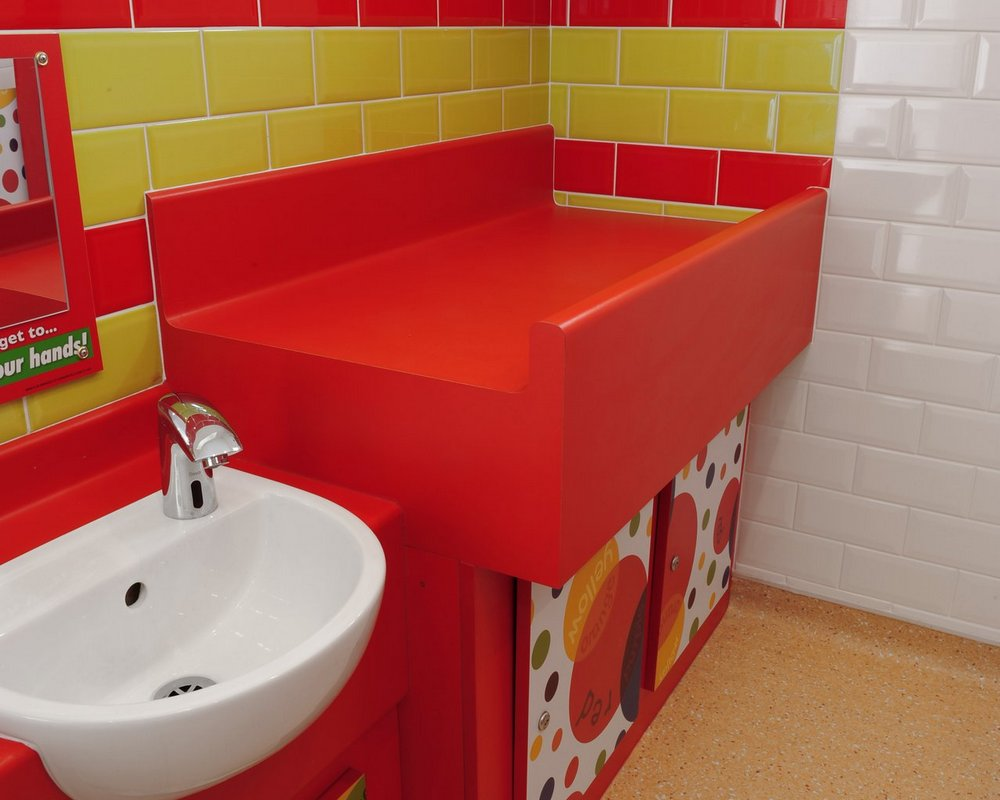 HPL Baby change unit in 'bright red' colour with laminate 'colour creations' under panels