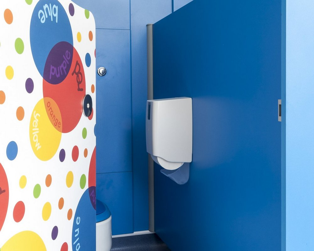 Tiny Stuff school cubicle with 'colour creations' colour doors and WC ducts in 'cobalt blue' colour