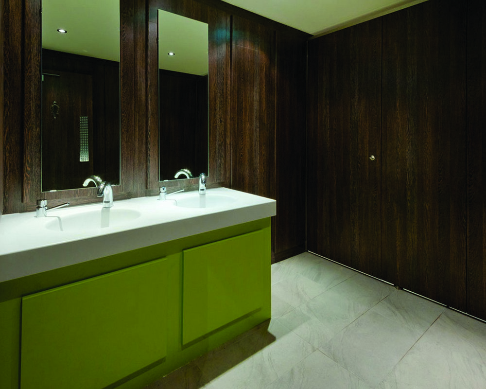 Solid surface counter top vanity and HPL under vanity panels in 'Zest'  Definition Cubicles and Ducting in 'American Walnut'