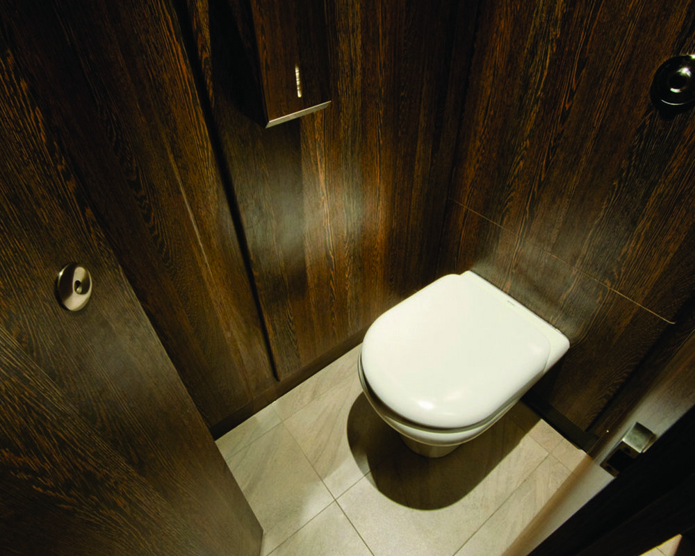 Ready plumbed back to wall WC duct with pilasters partition and door in 'American Walnut' with stainless steel fittings