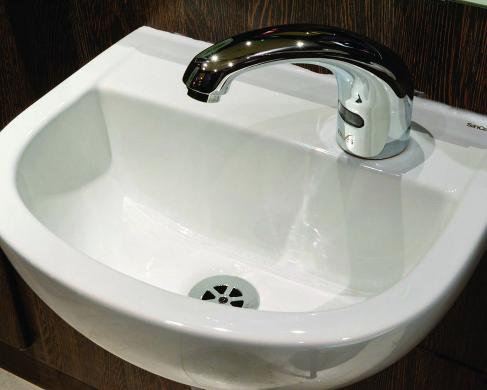 Accessible WC Wash Basin with right tap hole and DVS sensor mixer tap ready plumbed to 'American Walnut' ducts