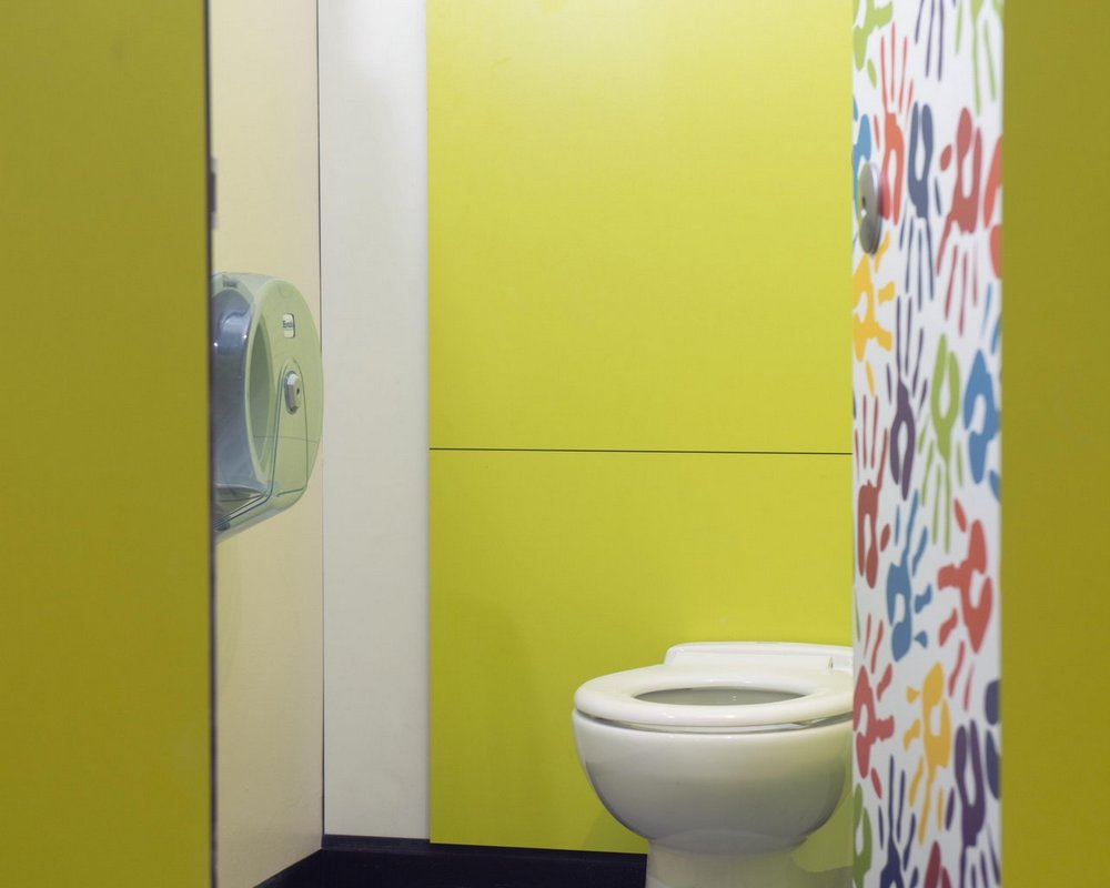 Primrose Hill toilet cubicles with door open and IPS with back to wall WC and jumbo toilet roll holder