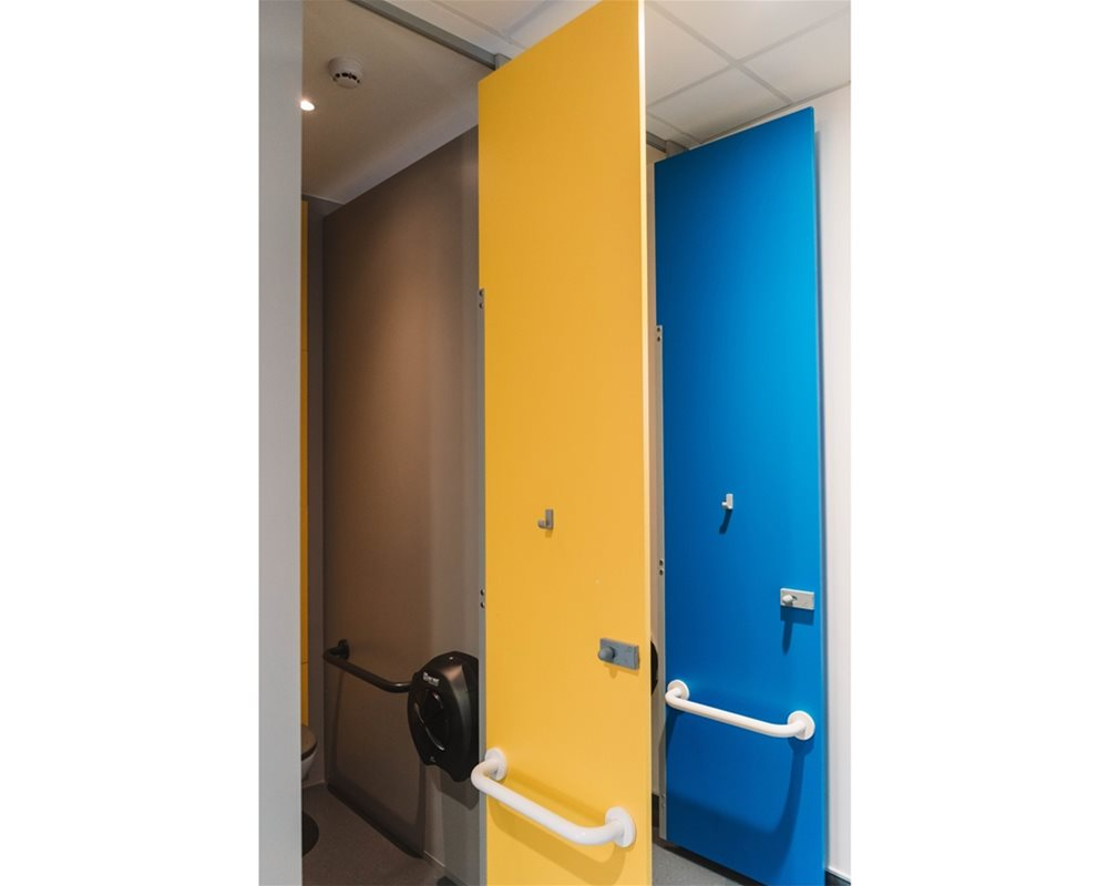 Bushboard Washrooms | HiZone full height school toilet cubicles | Outward opening cubicle door