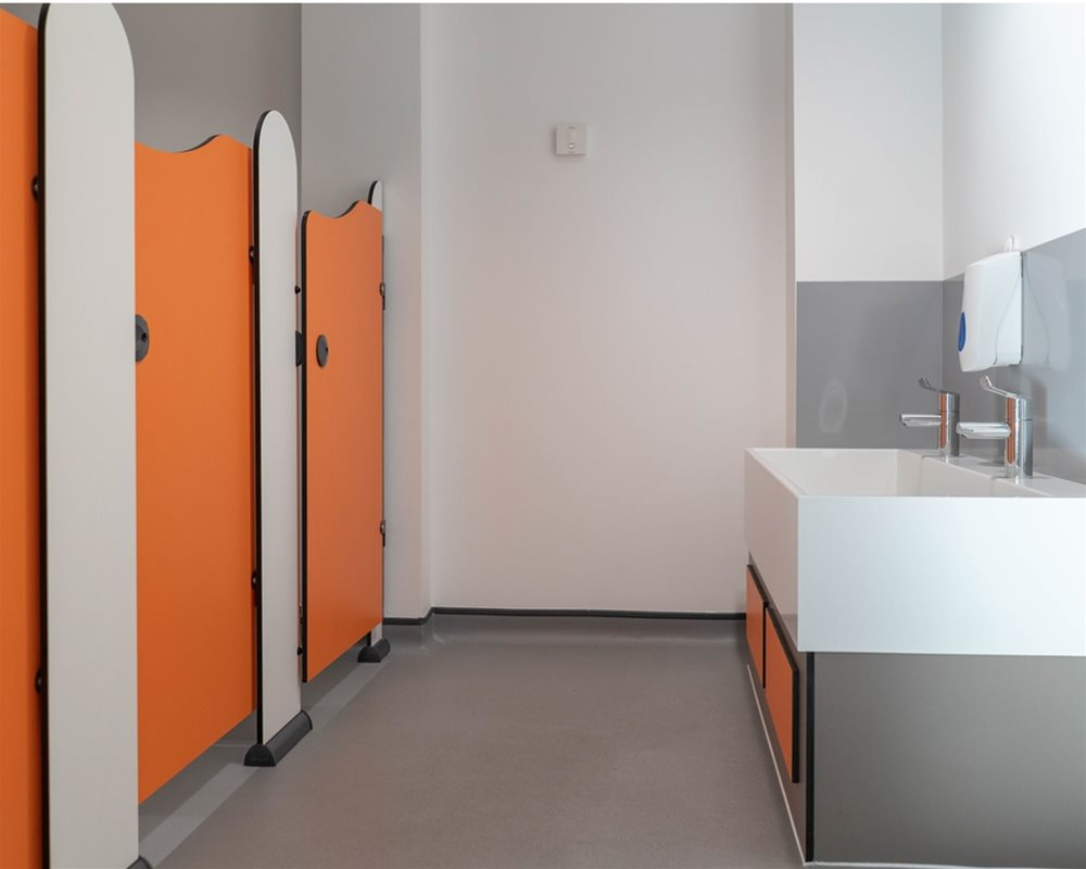 Tiny Stuff toilet cubicles in 'Tangerine' orange and 'Arctic' white for Ystalyfera nursery