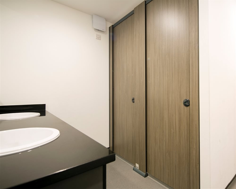 HiZone toilet cubicles in 'Silver Oak' laminate
