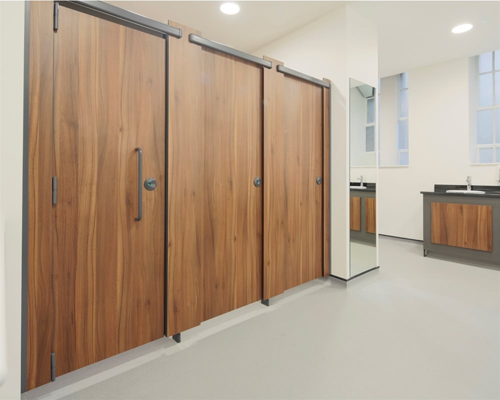 Profiles toilet cubicles in 'American Walnut' laminate for County Hall